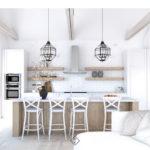 biała kuchnia z drewniana wyspą